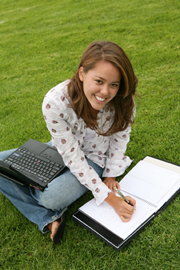 Student sitting on the grass